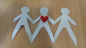 cut out of paper people holding hands